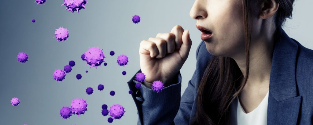 a woman coughs into her hand while graphics show the spread of a virus from coughing